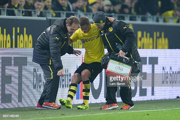 Sven Bender of Dortmund leaves injured the pitch during the Bundesliga match between Borussia Dortmund and Bayer Leverkusen at Signal Iduna Park on...