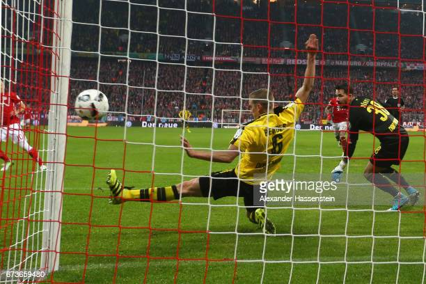 Sven Bender of Dortmund saves a shot next to his keeper Roman Buerki during the DFB Cup semi final match between FC Bayern Muenchen and Borussia...