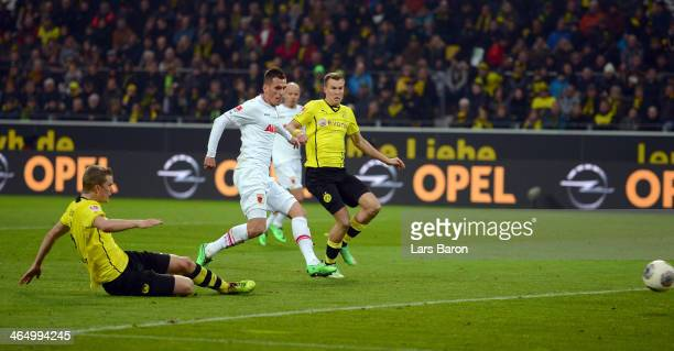 Sven Bender of Dortmund scores an own goal during the Bundesliga match between Borussia Dortmund and FC Augsburg at Signal Iduna Park on January 25...