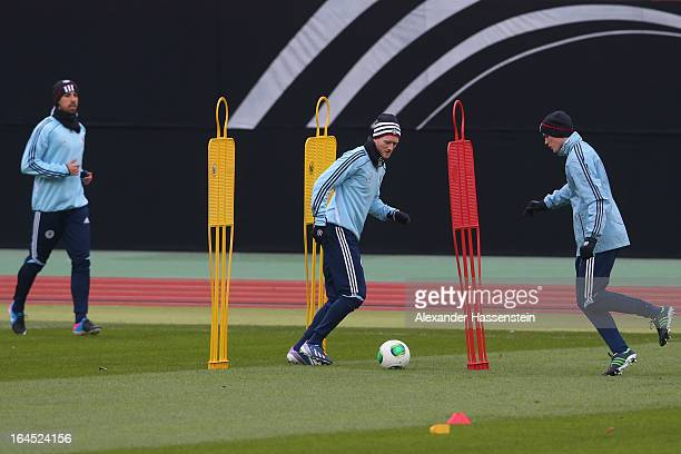 Sven Bender of Germany plays with his team mates Andre Schuerrle and Sami Khedira during a training session of the German national football team at...