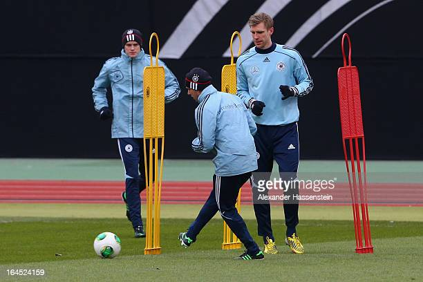 Sven Bender of Germany plays with his team mates Philipp Lahm and Per Mertesacker during a training session of the German national football team at...