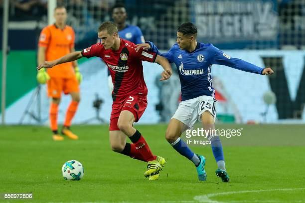 Sven Bender of Leverkusen and Amine Harit of Schalke battle for the ball during the Bundesliga match between FC Schalke 04 and Bayer 04 Leverkusen at...