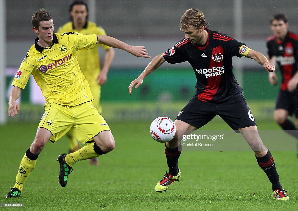 Sven Bendr of Dortmund challenges Sami Hyypiae of Leverkusen during the Bundesliga match between Bayer Leverkusen and Borussia Dortmund at BayArena...