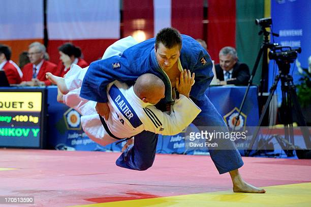 Sven Christiaens of Belgium throws Damien Altier of France for ippon during their M2 u90kgs contest at the 2013 European Veteran Judo Championships...