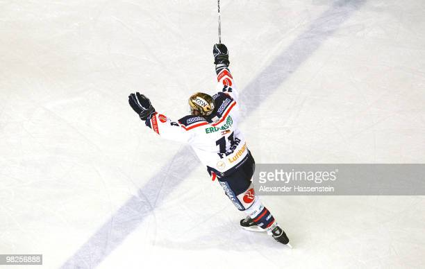 Sven Felski of Berlin celebrates after scoring his team's third goal during the fourth DEL quarter final playoff game between Augsburger Panther and...