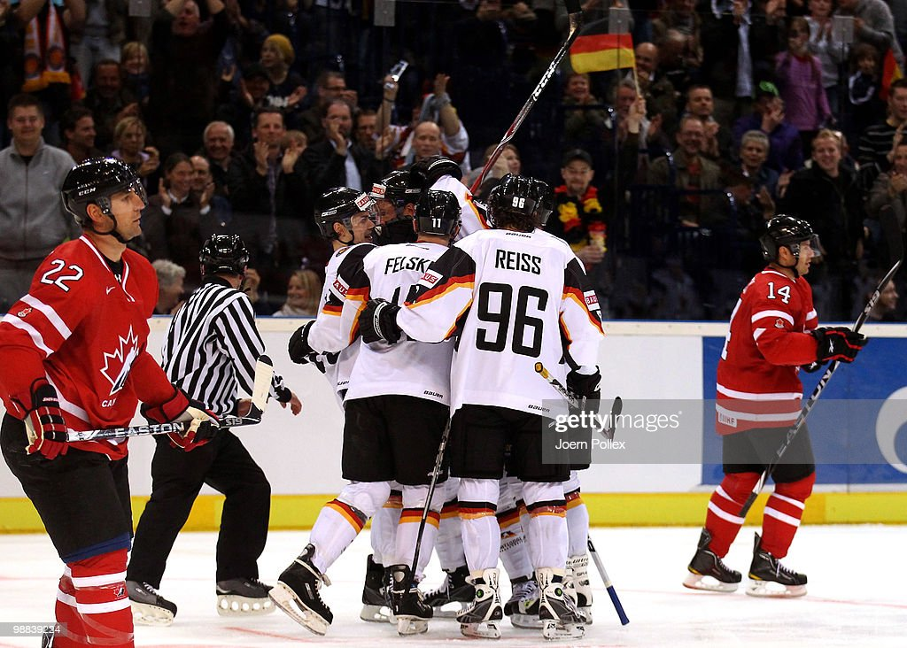 Sven Felski of Germany celebrates with his team mates after scoring his team's first goal during the pre IIHF World Championship match between...