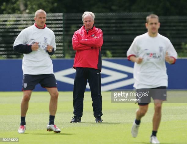 Sven Goran Eriksson of England keeps a watchful eye on David Beckham and Michael Owen during training at the Manchester City Training ground in...