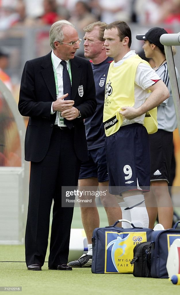 Sven Goran Eriksson (L) the coach of England, speaks with Wayne Rooney (R) of England, as he prepares to make his first appearance of the World Cup, by coming on as a second half substitute for Michael Owen during the FIFA World Cup Germany 2006 Group B match between England and Trinidad and Tobago at the Frankenstadion on June 15, 2006 in Nuremberg, Germany.