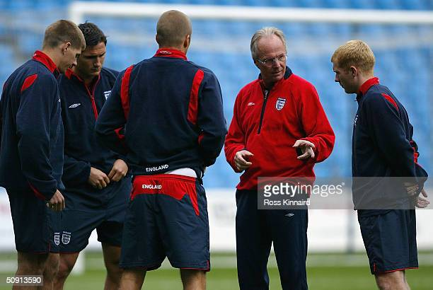 Sven Goran Eriksson the manager of England talks to Steven Gerrard Frank Lampard David Beckham and Paul Scholes during the teams training session at...
