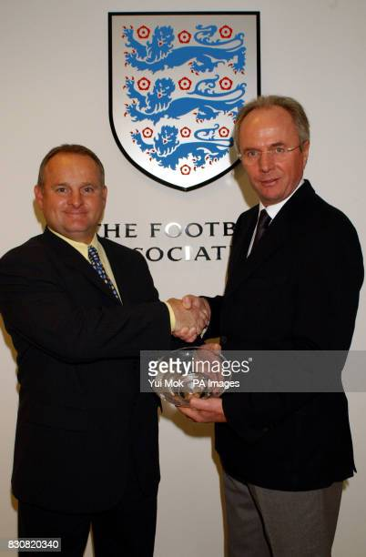 Sven GoranEriksson with his England Coach of the Year 2001 award presented by the director of Creating Execellence at the FA headquarters in Soho...