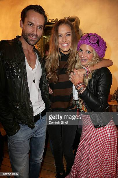 Sven Hannawald Alena Gerber and Nina Hey attend the 'House of Capulet' shop opening on November 29 2013 in Munich Germany