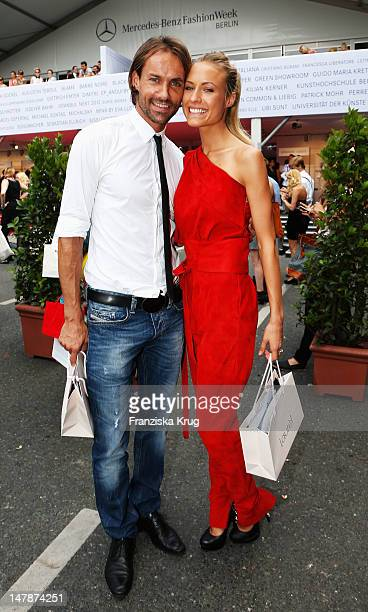 Sven Hannawald and Alena Gerber arrive for the Laurel Show at the MercedesBenz Fashion Week Spring/Summer 2013 on July 5 2012 in Berlin Germany