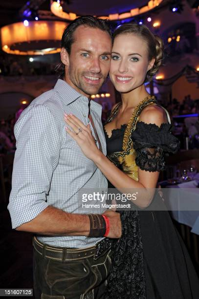 Sven Hannawald and his girlfriend Alena Gerber attend the Angermaier WiesnFashion Show at the Loewenbraeukeller on September 8 2012 in Munich Germany