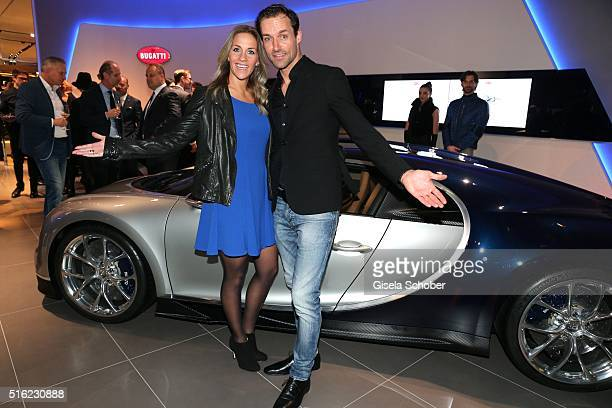 Sven Hannawald and his girlfriend Melissa Thiem at the 'Chiron' car during the Bugatti boutique opening on March 17 2016 in Munich Germany