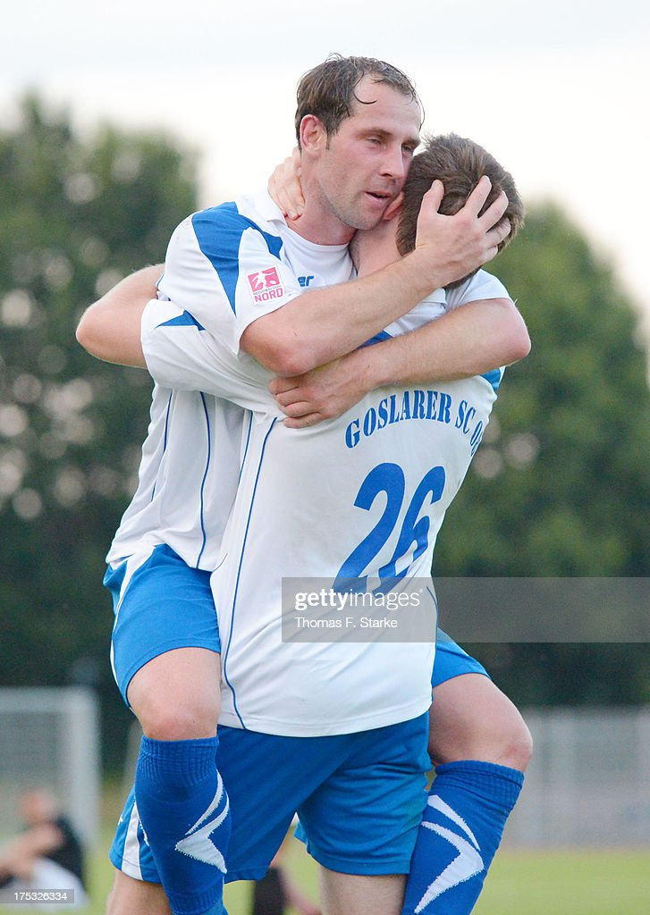 Sven Hartwig (L) and Thomas Stroehl of Goslar celebrate after winning the Regionalliga North match between BV Cloppenburg and Goslarer SC at stadium Cloppenburg on August 2, 2013 in Cloppenburg, Germany.
