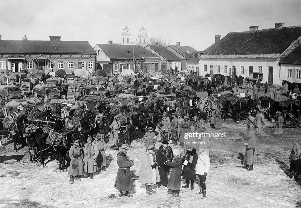 Jewish children and adults in the street of a Polish village or ...