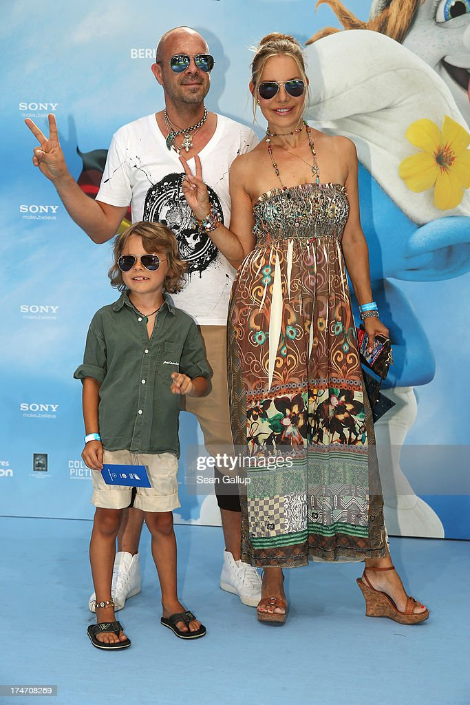 Sven Kilthau-Lander, Xenia Seeberg and son Philip-Elias Martinek attend the 'Die Schluempfe 2' Germany Premiere at Sony Centre on July 28, 2013 in Berlin, Germany.