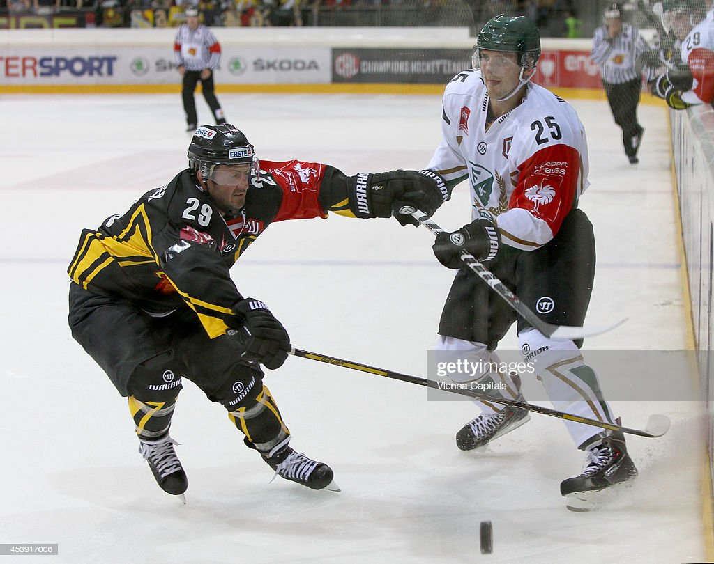 Sven Klimbacher (Capitals) and Anton Hedman (Faerjestad) in action during the Champions Hockey League group stage game between Vienna Capitals and Faerjestad Karlstad on August 21, 2014 in Vienna, Austria.