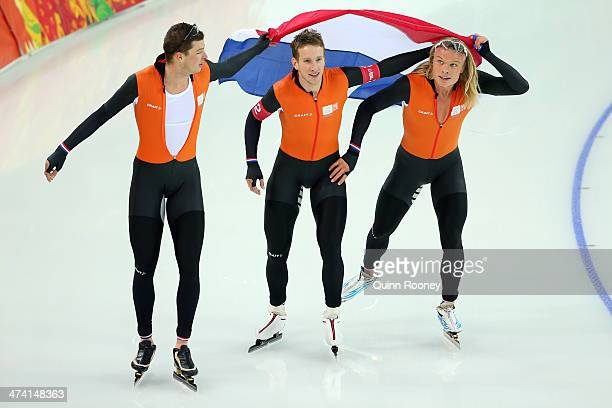 Sven Kramer Jan Blokhuijsen and Koen Verweij of the Netherland celebrate winning the gold medal during the Men's Team Pursuit Final A Speed Skating...