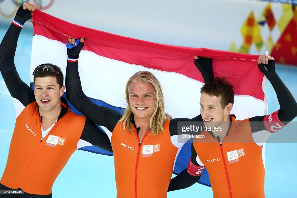 <a gi-track='captionPersonalityLinkClicked' href=/galleries/search?phrase=Sven+Kramer&family=editorial&specificpeople=769363 ng-click='$event.stopPropagation()'>Sven Kramer</a>, <a gi-track='captionPersonalityLinkClicked' href=/galleries/search?phrase=Koen+Verweij&family=editorial&specificpeople=4900695 ng-click='$event.stopPropagation()'>Koen Verweij</a> and <a gi-track='captionPersonalityLinkClicked' href=/galleries/search?phrase=Jan+Blokhuijsen&family=editorial&specificpeople=4900694 ng-click='$event.stopPropagation()'>Jan Blokhuijsen</a> of the Netherland celebrate winning the gold medal during the Men's Team Pursuit Final A Speed Skating event on day fifteen of the Sochi 2014 Winter Olympics at at Adler Arena Skating Center on February 22, 2014 in Sochi, Russia.