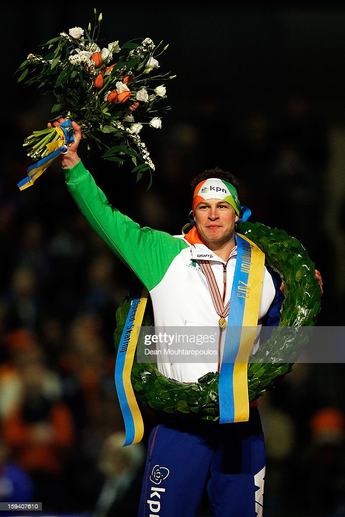 <a gi-track='captionPersonalityLinkClicked' href=/galleries/search?phrase=Sven+Kramer&family=editorial&specificpeople=769363 ng-click='$event.stopPropagation()'>Sven Kramer</a> of Netherlands celebrates becoming the European Champion with his medal, wreath and flowers during the Final Day of the Essent ISU European Speed Skating Championships 2013 at Thialf Stadium on January 13, 2013 in Heerenveen, Netherlands.