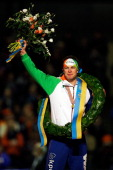 Sven Kramer of Netherlands celebrates becoming the European Champion with his medal wreath and flowers during the Final Day of the Essent ISU...