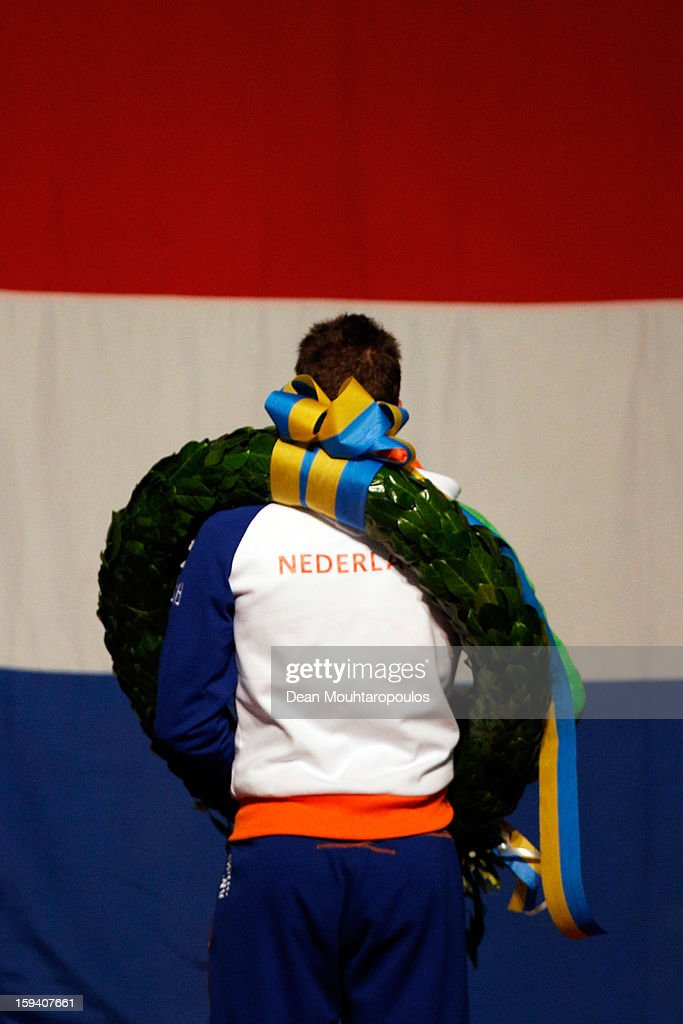 Sven Kramer of Netherlands celebrates becoming the European Champion with his medal, wreath and flowers and stands for the national anthem during the Final Day of the Essent ISU European Speed Skating Championships 2013 at Thialf Stadium on January 13, 2013 in Heerenveen, Netherlands.