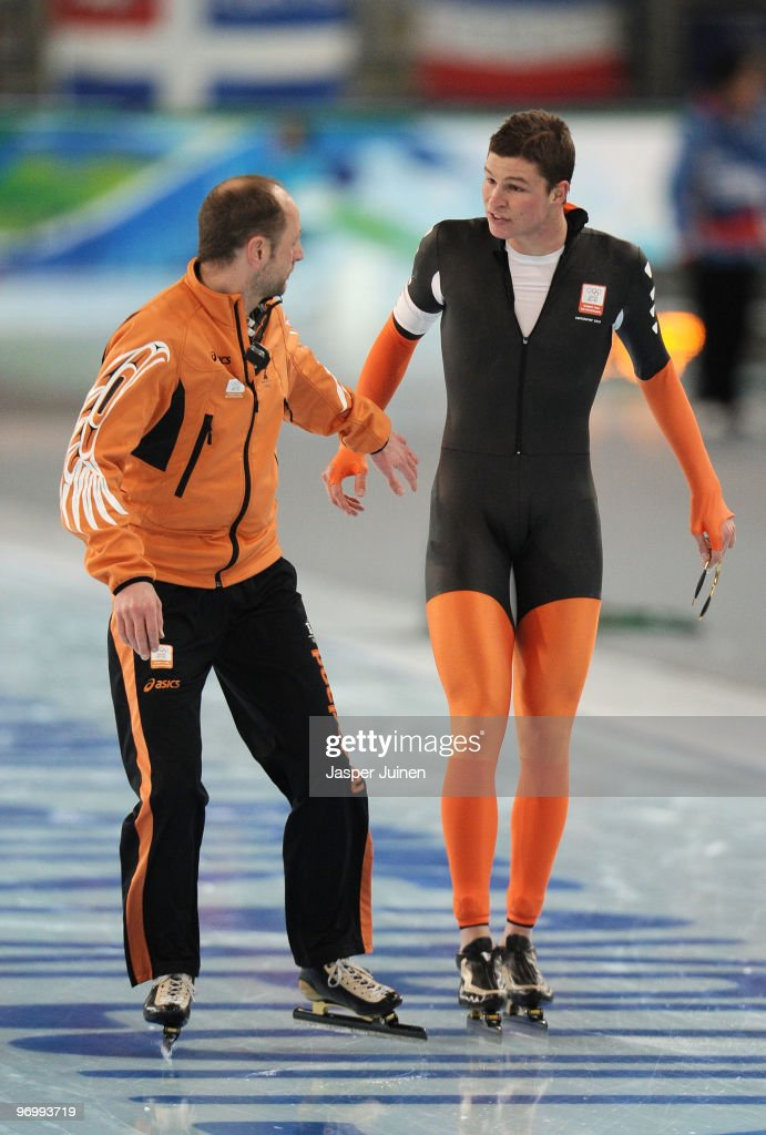 <a gi-track='captionPersonalityLinkClicked' href=/galleries/search?phrase=Sven+Kramer&family=editorial&specificpeople=769363 ng-click='$event.stopPropagation()'>Sven Kramer</a> of Netherlands reacts with coach Gerard Kemkers after finishing first but being disqualified in the men's speed skating 10000 m on day 12 of the 2010 Vancouver Winter Olympics at Richmond Olympic Oval on February 23, 2010 in Vancouver, Canada.