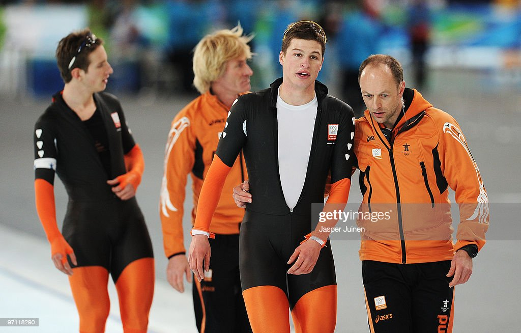 <a gi-track='captionPersonalityLinkClicked' href=/galleries/search?phrase=Sven+Kramer&family=editorial&specificpeople=769363 ng-click='$event.stopPropagation()'>Sven Kramer</a> of team Netherlands is consoled by coach Gerard Kemkers in the Men's Team Pursuit Speed Skating Semi-Finals on day 15 of the 2010 Vancouver Winter Olympics at Richmond Olympic Oval on February 26, 2010 in Vancouver, Canada.