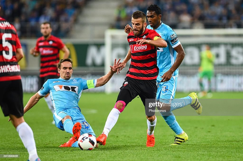 Sven Kums gets a yellow card for this tackle on Feran Hasani during the Uefa Europa League match between KAA Gent and KF Shkendija In the Ghelamco...