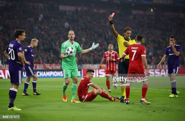Sven Kums of RSC Anderlecht is shown a red card by referee Paolo Tagliavento during the UEFA Champions League group B match between Bayern Muenchen...