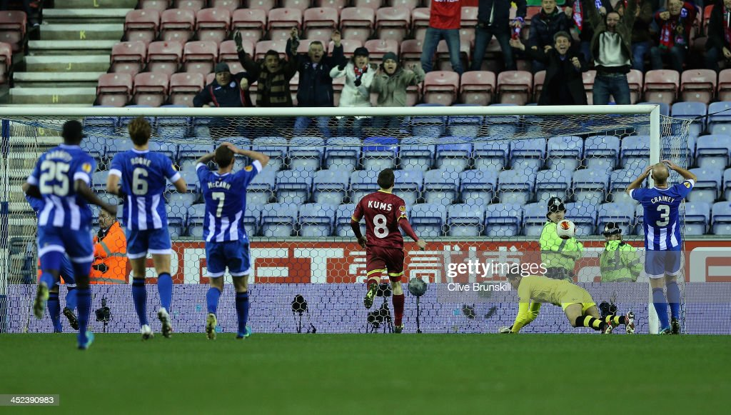 Sven Kums of SV Zulte Waregem watches as Wigan Athletic keeper Lee Nicholls is beaten for his teams first goal during the UEFA Europa League Group D...