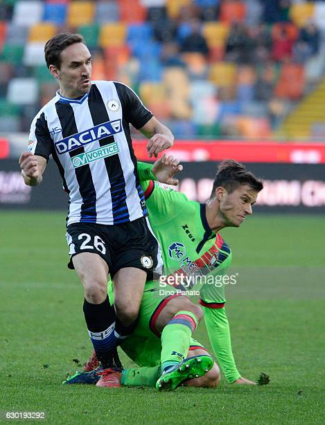 Sven Kums of Udinese Calcio competes with Marcus Christer Rohden of FC Crotone during the Serie A match between Udinese Calcio and FC Crotone at...