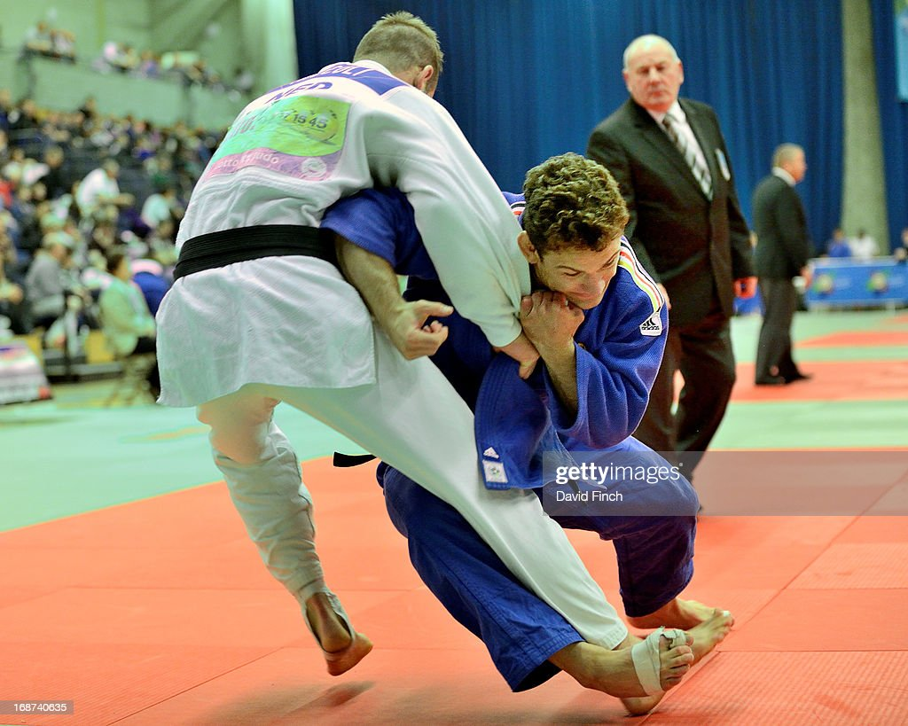 Sven Maresch of Germany (blue) defeated David Miccoli of the Netherlands by ippon (10 points) during their u81kgs repercharge contest on day 2 of the London British Open Judo Championships at the K2 on May 12, 2013 in Crawley, United Kingdom.