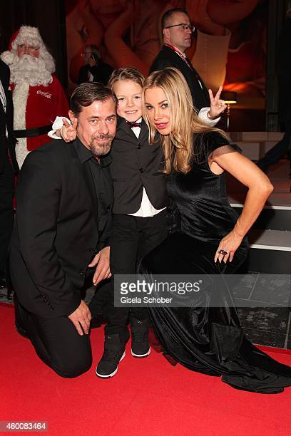 Sven Martinek Xenia Seeberg and their son PhilipElias attend the Ein Herz fuer Kinder Gala 2014 after show party at Tempelhof Airport on December 6...