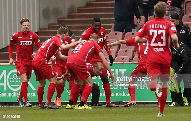 Sven Michel of Cottbus jubilates with team mates after scoring the first goal during the third league match between FC Energie Cottbus and 1FC...