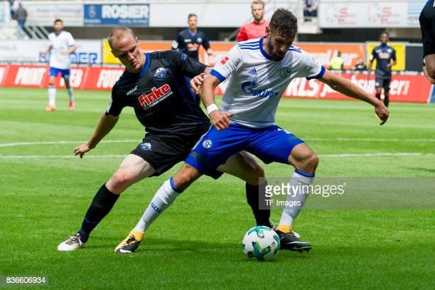 Sven Michel of Paderborn and Daniel Caligiuri of Schalke battle for the ball during the preseason friendly match between SC Paderborn and FC Schalke...