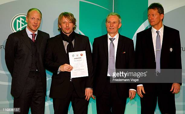 Sven Mislintat receives his DFB Football Trainer Certificate from Matthias Sammer Rainer Milkoreit and Frank Wormuth at the hotel Wasserturm on March...