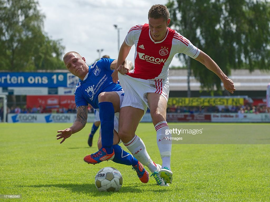 Sven Onclin of SDC Putten, Derk Boerrigter of Ajax during the pre season friendly match between SDC Putten and Ajax on June 29, 2013 in Putten, The Netherlands.