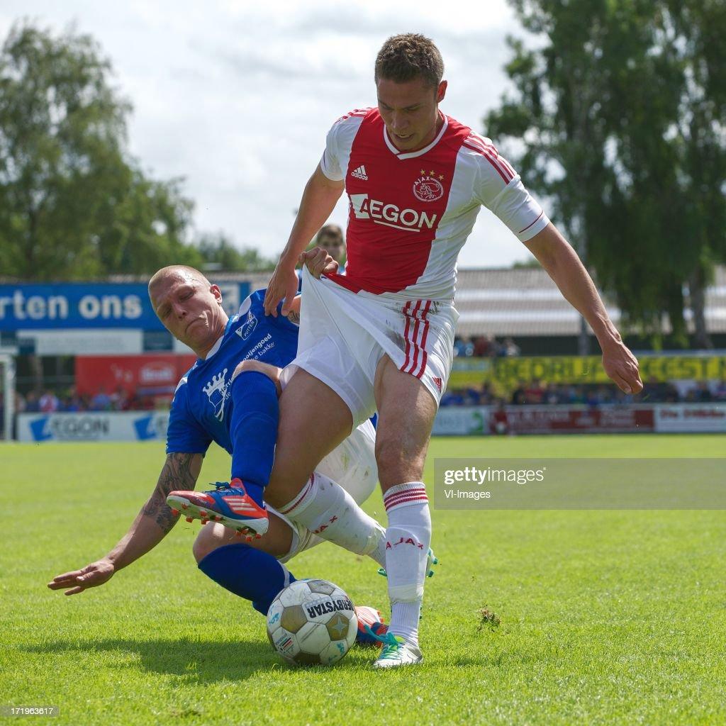 Sven Onclin of SDC Putten, Derk Boerrigter of Ajax during the pre season friendly match between SDC Putten and Ajax on June 29, 2013 in Putten, The Netherlands.