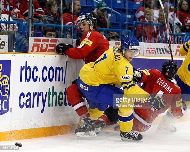 Sven Ryser of Team Switzerland and David Rundblad of Team Sweden battle for the puck during the 2010 IIHF World Junior Championship Tournament Bronze...