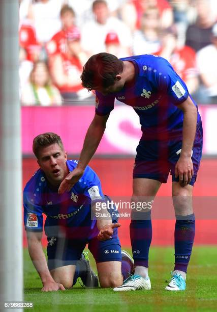 Sven Schipplock and Sandro Sirigu of Dramstadt look dejected after being relagated after the Bundesliga match between Bayern Muenchen and SV...