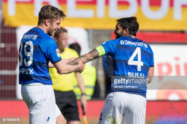 Sven Schipplock of Darmstadt celebrates his team's third goal with team mate Aytac Sulu during the Bundesliga match between SV Darmstadt 98 and SC...