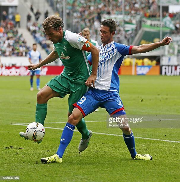 Sven Schipplock of Hoffenheim and Clemens Fritz of Bremen compete for the ball during the Bundesliga match between 1899 Hoffenheim and SV Werder...