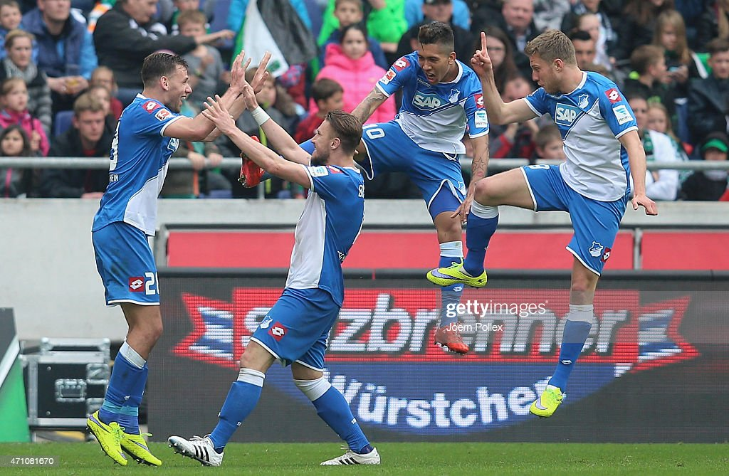 Sven Schipplock of Hoffenheim celebrates with his team mates after scoring his team's second goal during the Bundesliga match between Hannover 96 and...