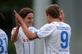Sven Schipplock of Hoffenheim celebrates with teammate Sebastian Rudy after scoring his team's second goal during the friendly match between...