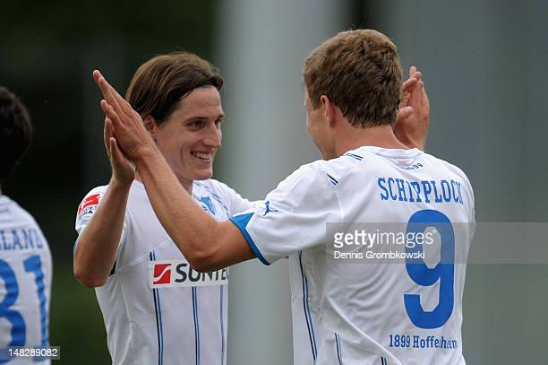 Sven Schipplock of Hoffenheim celebrates with teammate Sebastian Rudy after scoring his team's second goal during the friendly match between...