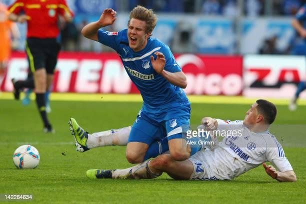 Sven Schipplock of Hoffenheim is challenged by Kyriakos Papadopoulos of Schalke during the Bundesliga match between 1899 Hoffenheim and FC Schalke 04...