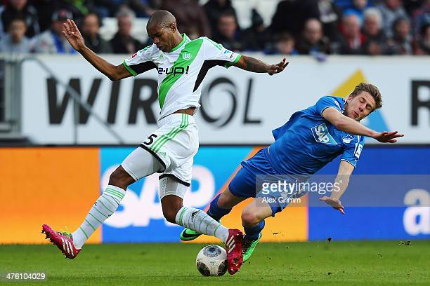 Sven Schipplock of Hoffenheim is challenged by Naldo of Wolfsburg during the Bundesliga match between 1899 Hoffenheim and VfL Wolfsburg at Wirsol...