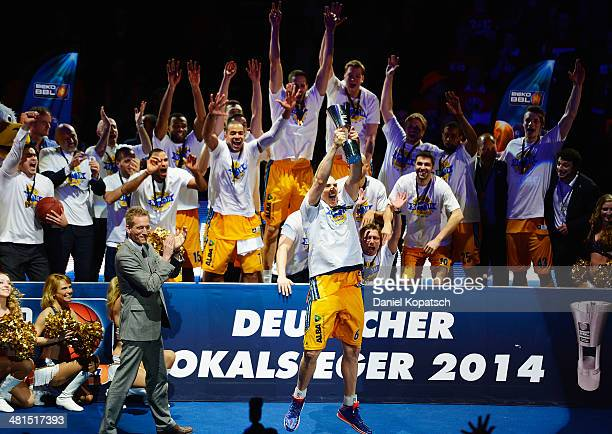 Sven Schultze of Berlin celebrates with team mates after the Beko BBL Top Four final match between Alba Berlin and ratiopharm Ulm at ratiopharm arena...
